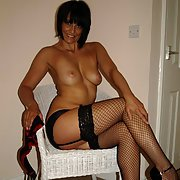 Mature very sexy brunette posing for all her followers wearing lingerie