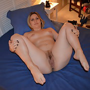 MissC on the bed enjoying herself as she feels her pussy