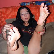 Angel a tattooed amateur showing her sexy feet at home