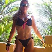 Great milf sexy blonde in bikini revealing fine body in the summer sun
