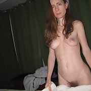 A skinny hairy MILF shows off her hot sexy body and hairy snatch