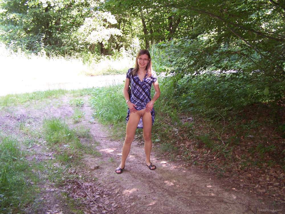 Wife hitching up her dress exposing herself in the woods
