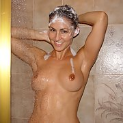 Gorgeous brunette takes a shower and shows us her lovely body
