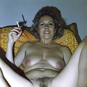 My slutty friend Helga shows to the world her hairy pussy smoking