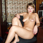 Oksana Sits Down by the Desk Naked