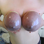 Submissive slave with tied tits