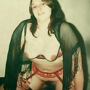 My wife in her red suspender's and black stockings