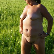 My wife naked In the field taking in the sun