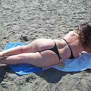 Sexy wife 32 years old milf sunbathing on a public beach