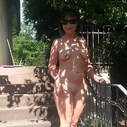 Horny woman naked in the back yard sunbathing lovely natural tits