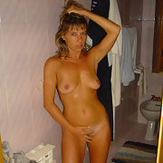 Naked MILF parading herself around the house and up for sex