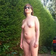 Horny Milf naked in the back yard sunbathing showing off mature body