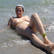 My sexy wife we love to share photos sunbathing nude in beach surf