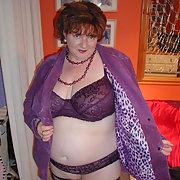 Purple Bra and fishnets.