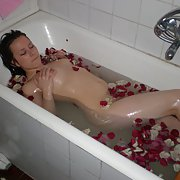 Return of petite brunette who takes a bath with flowers