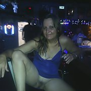 Having a little daring fun at the bar in her slutty blue dress