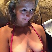 Mature blonde with huge tits, with top pulled down to reveal them