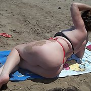 32 year old wife having photos taken on a beach in her bikini