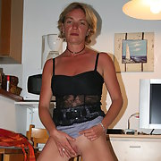 Mature busty woman exposing her tits on boat and showing fanny