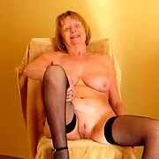 Mature 60+ year old married lady enjoys explicit posing