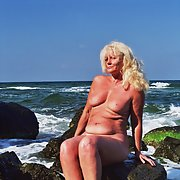 Hot grany tanning on the seaside nude in public