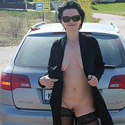 Sexy lady exhibitionist flasher outdoors in public flaunting her body