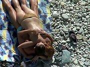 Sexy nude bitch fucking on a pebble beach voyeur sex video