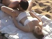 Big tit brunette gets licked out and fucked at the beach