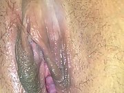 Rubbing wet and swollen pussy while husband is gone
