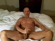 Spreading my legs and playing with my cock on camera
